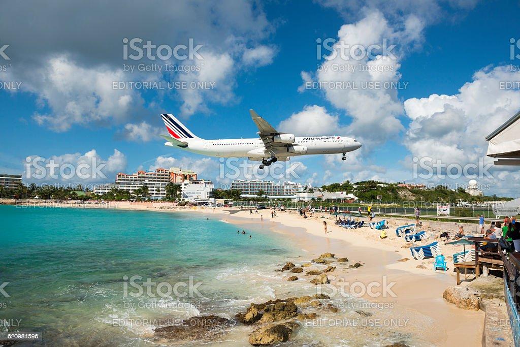 Air France flying over Maho Beach, St. Maarten stock photo