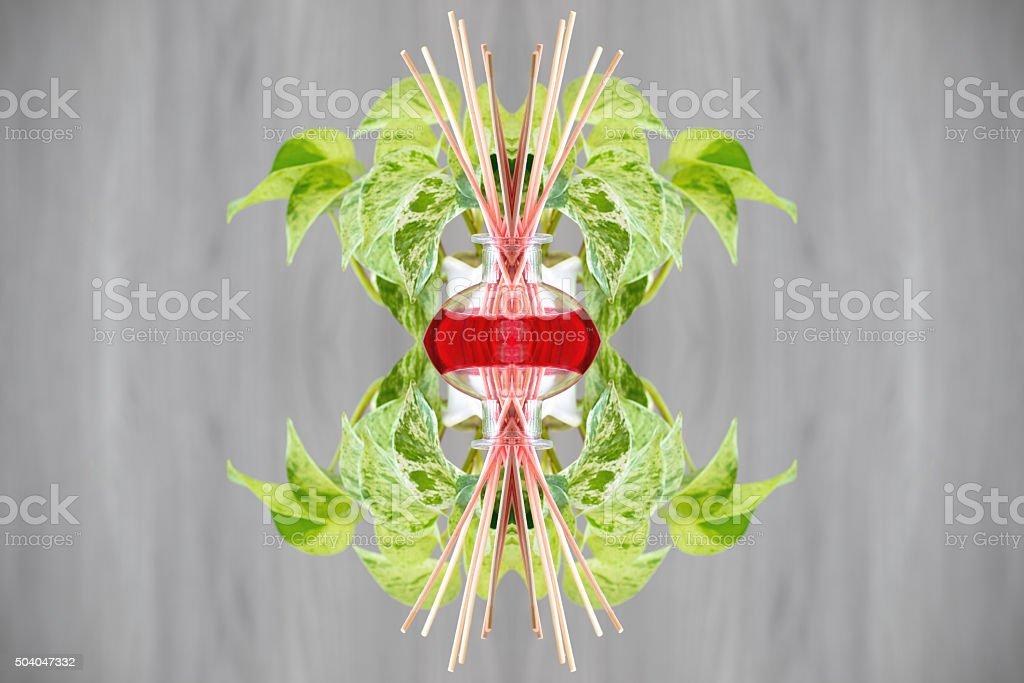 Air freshener and green plant surreal shaped symmetrical kaleidoscope stock photo