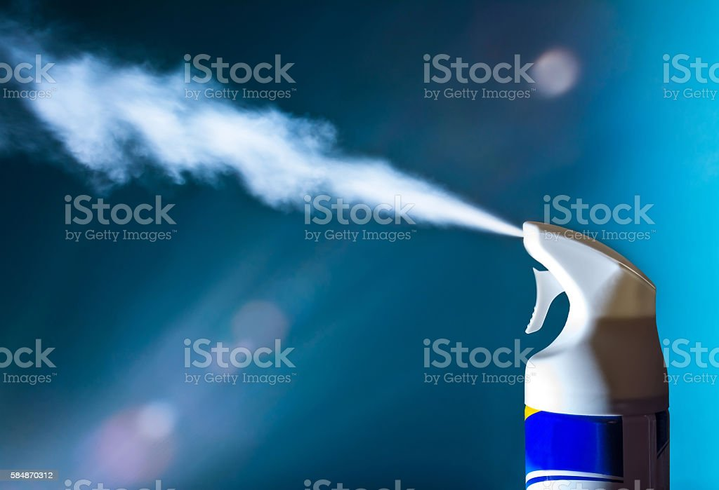 Air freshener spray aerosols in the light of sun stock photo