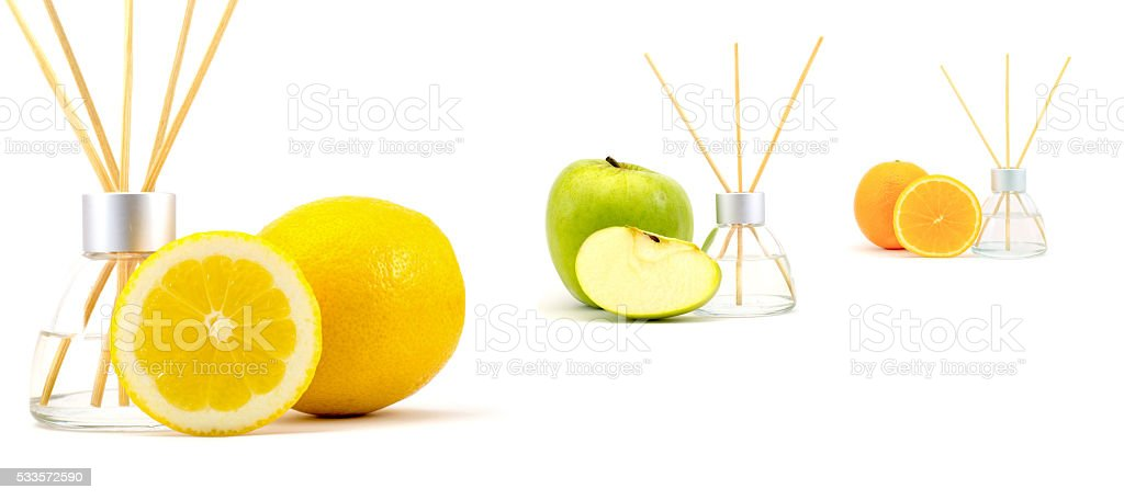 Air freshener sticks with apple, lemon, orange isolated stock photo