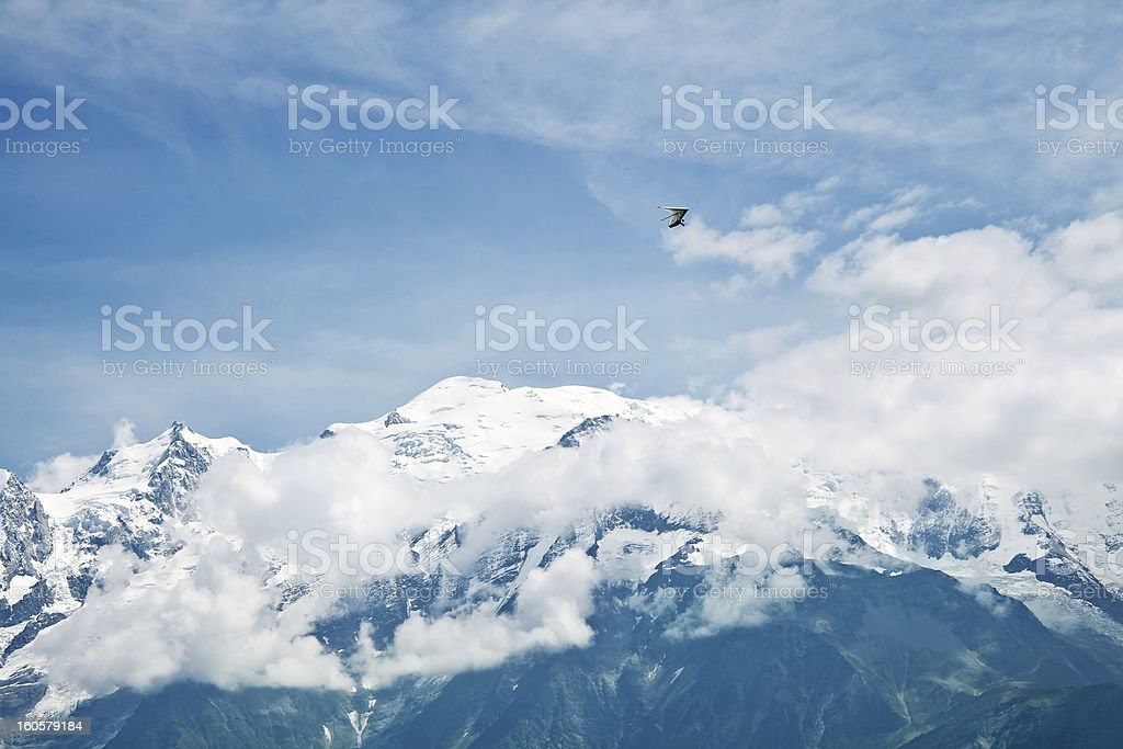 Air glider flies above snowy picks of Mont-Blank massif stock photo