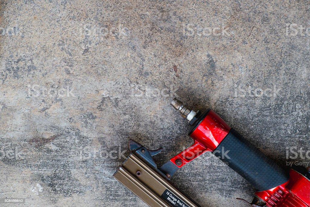 air gun on cement background stock photo