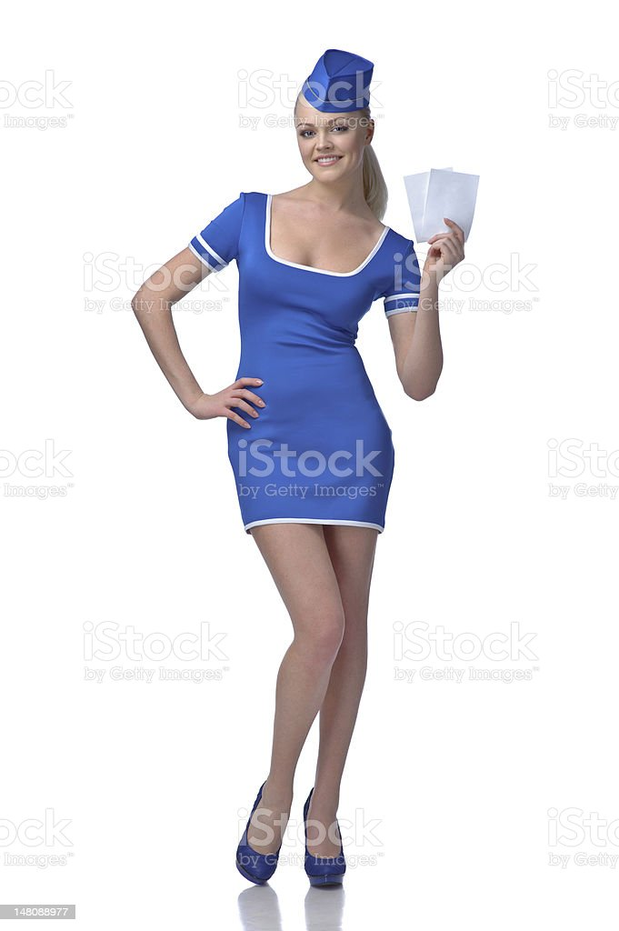 Air hostess holding two tickets to the flight royalty-free stock photo