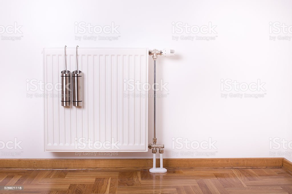 Air humidifier container on radiator stock photo
