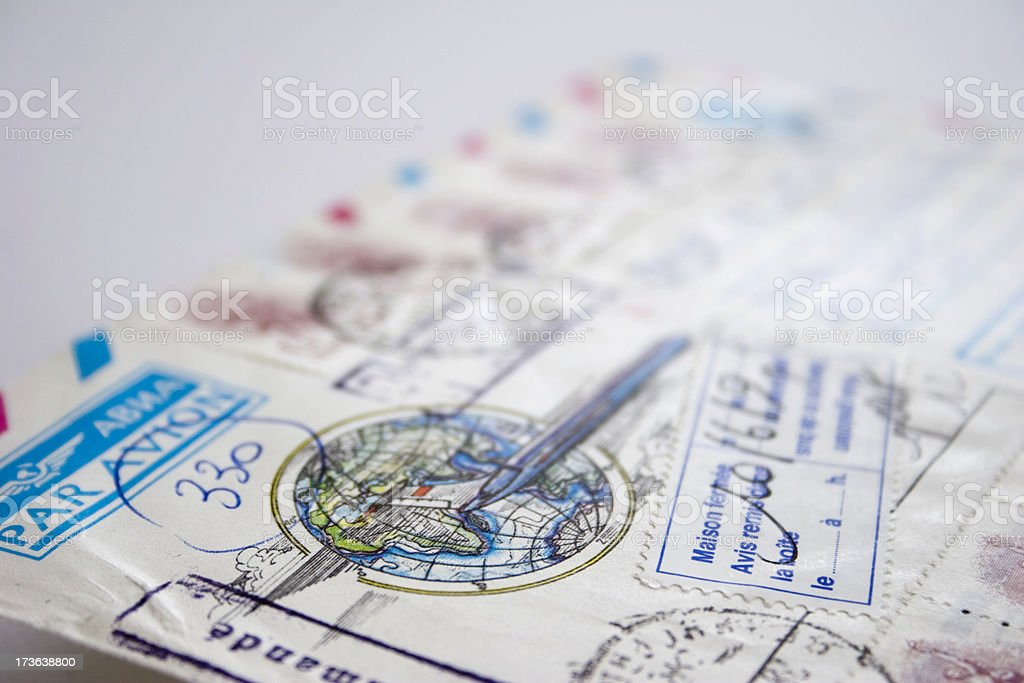 Air mail letter with globe and stamps stock photo