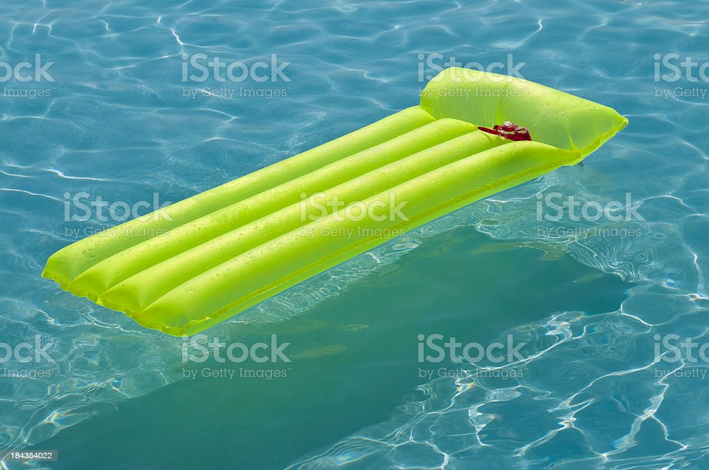air mattress in pool royalty-free stock photo