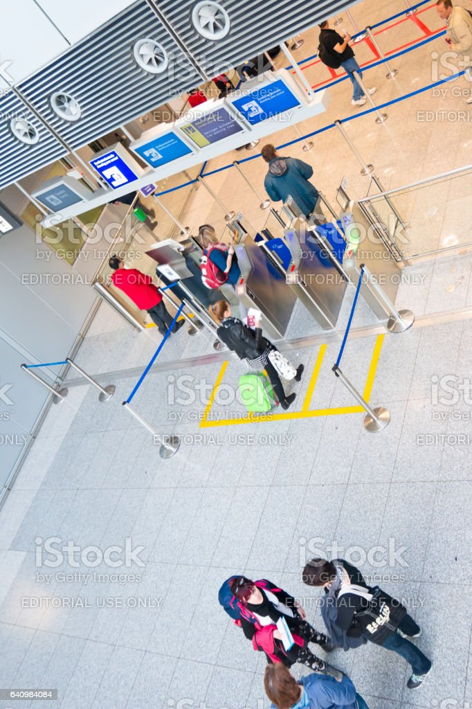 Air passengers entering a automated boarding ticket control stock photo