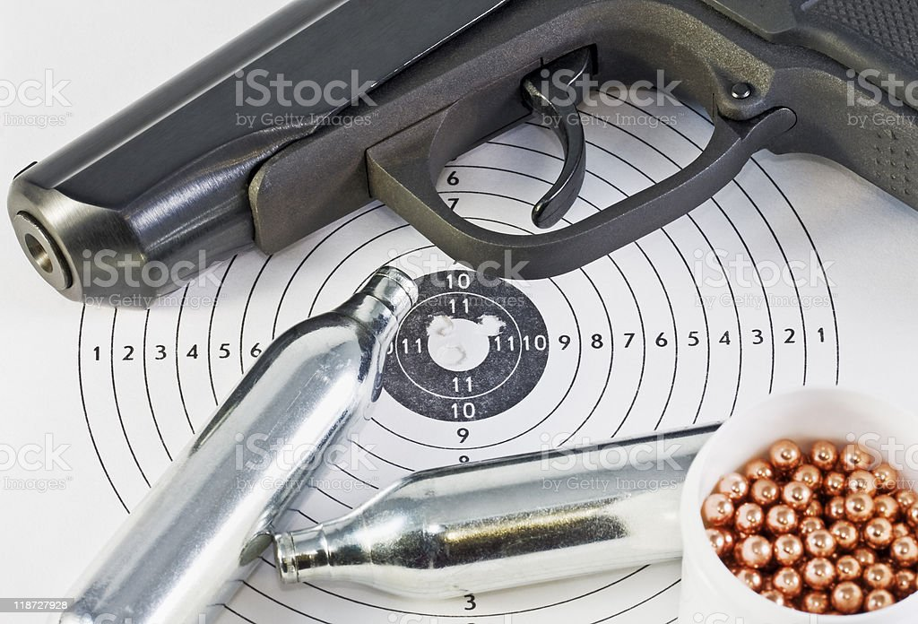 air pistol and spare parts for weapons stock photo