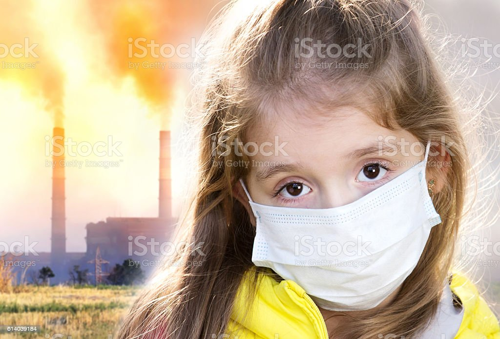 Air pollution dirty environment concept. Chld in mask. stock photo