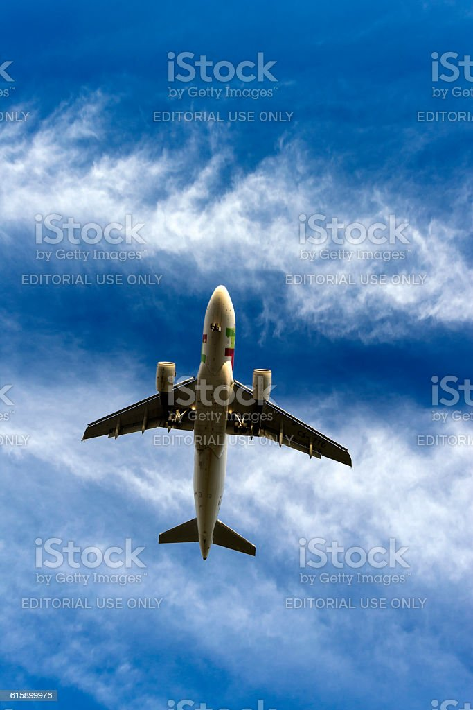 Air Portugal airplane landing in sunset stock photo