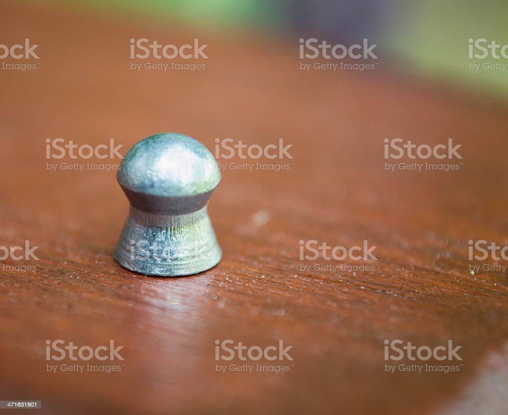Air Rifle Pellet on Wood royalty-free stock photo