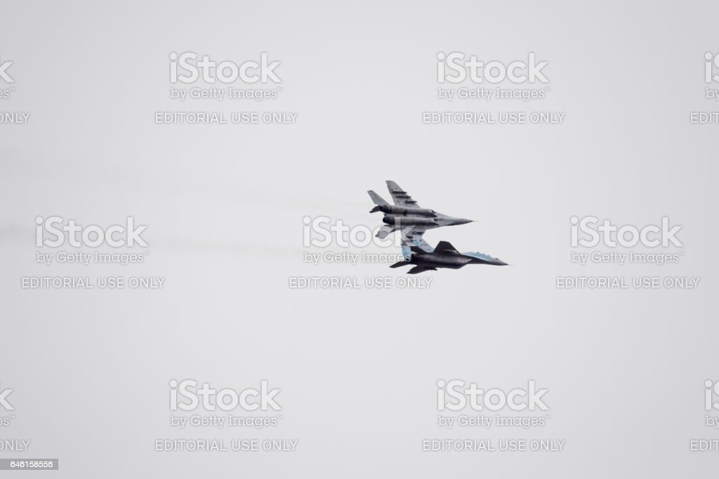 Air show in the sky above the Krasnodar airport flight school. Airshow in honor of Defender of the Fatherland. MiG-29 in the sky. stock photo