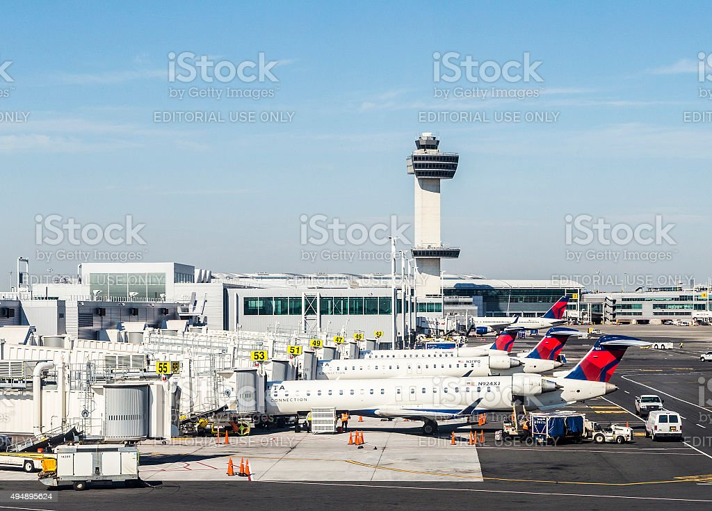 Air Traffic Control Tower and Terminal 4 with Air planes stock photo