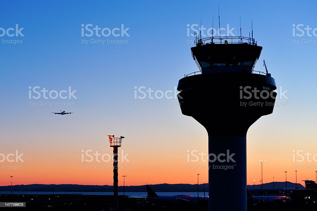 Air traffic control tower at sunset stock photo