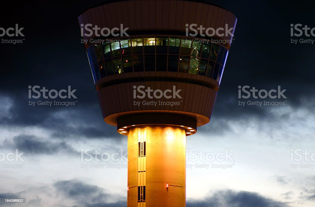 Air traffic control tower on a cloudy evening royalty-free stock photo