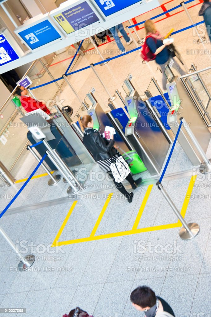 Air travelers entering a automated boarding ticket control stock photo