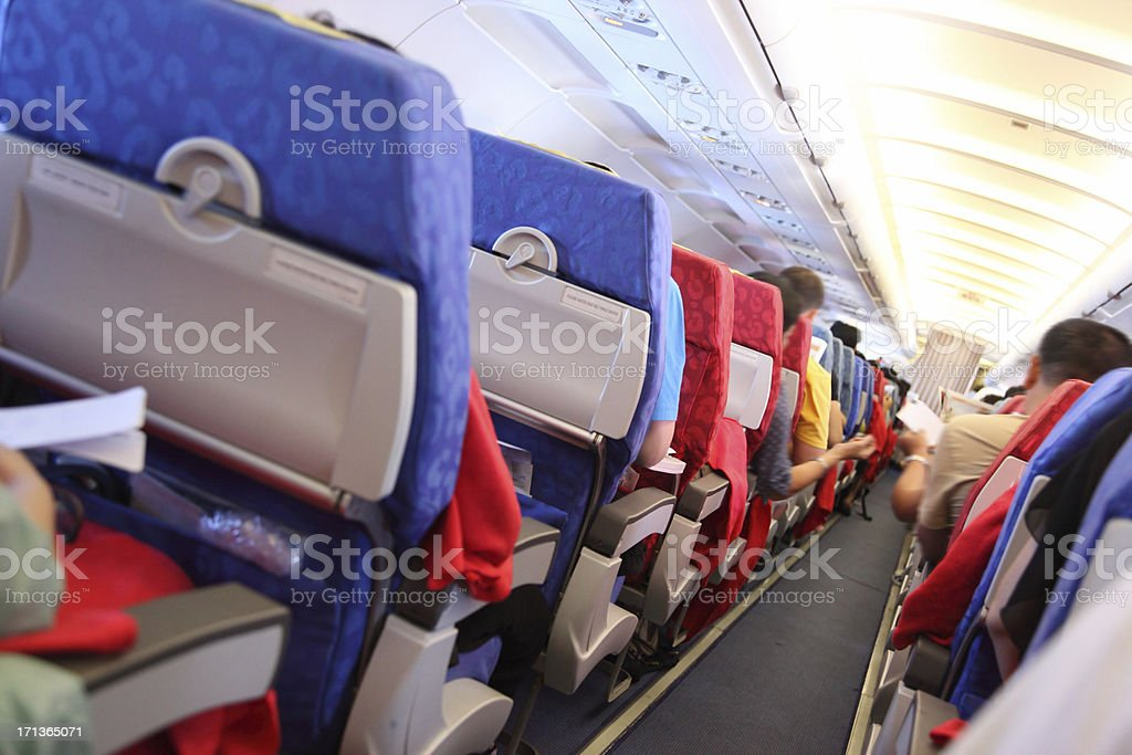 Air Travelers in Airplane Cabin royalty-free stock photo