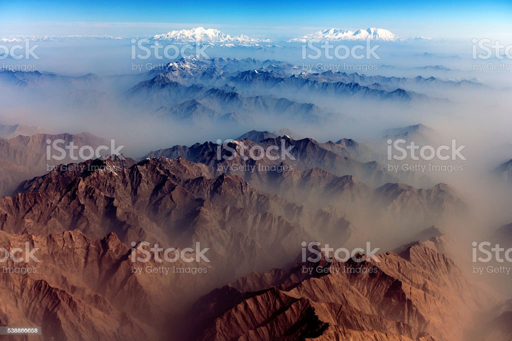 Air view , Pakistan mountains along the way to Osaka stock photo