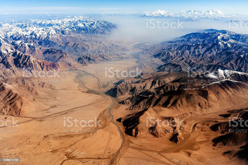 Air view , Pakistan mountains along the way to Osaka stock photo