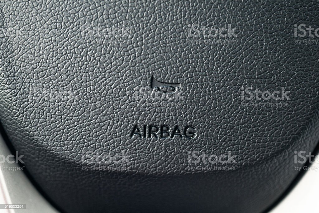 Airbag on the steering wheel of the car stock photo