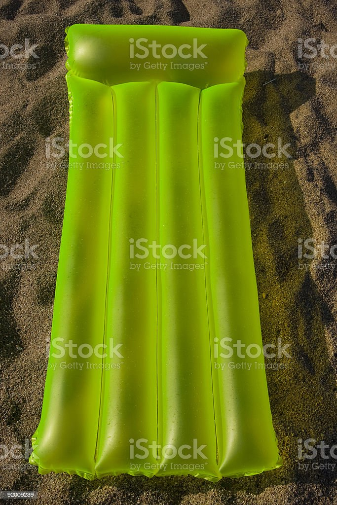 airbed lying on a sand royalty-free stock photo