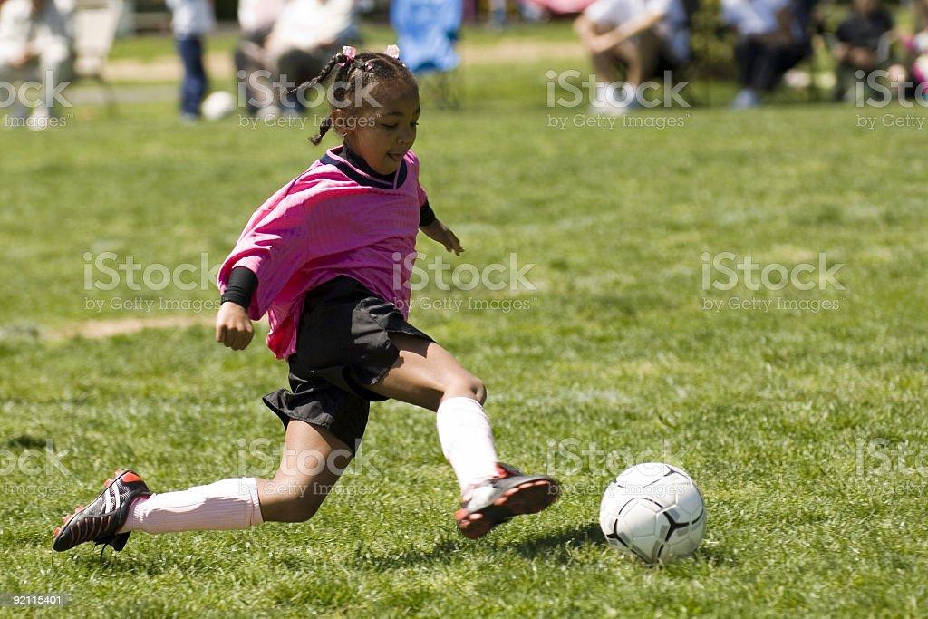 Airborne Powerful Soccer Kick royalty-free stock photo