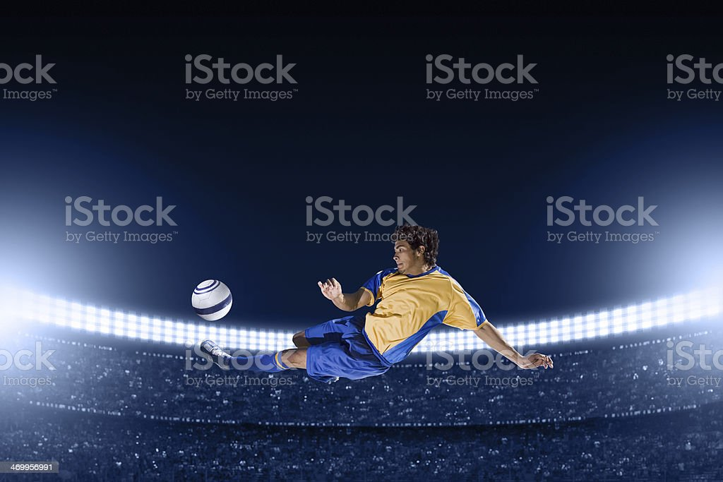 Airborne Soccer Player Doing a Side Volley Kick at stadium stock photo