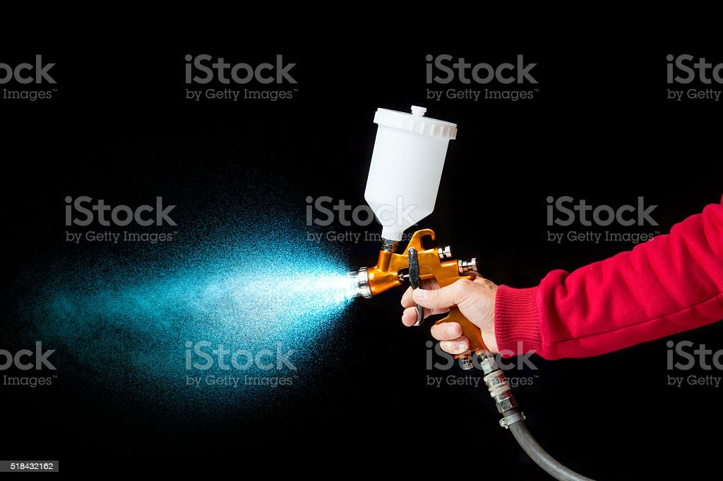 airbrush paint sprayer on black stock photo