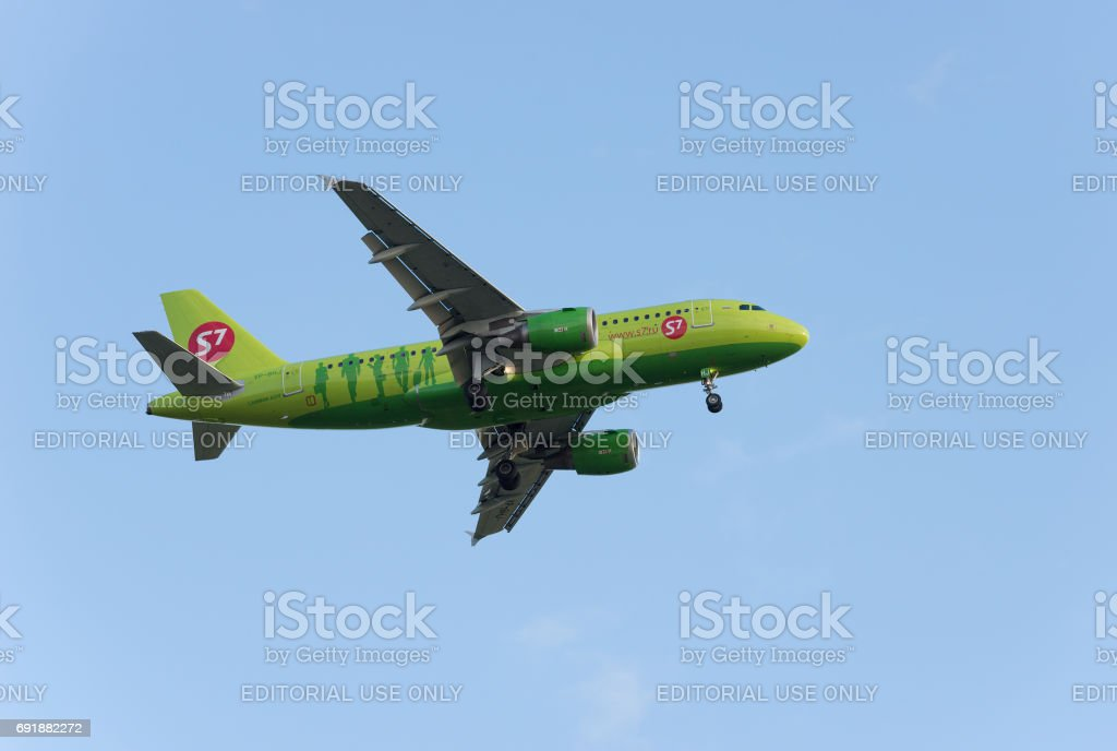 S7 Airbus A319 landing at Pulkovo international airport. stock photo