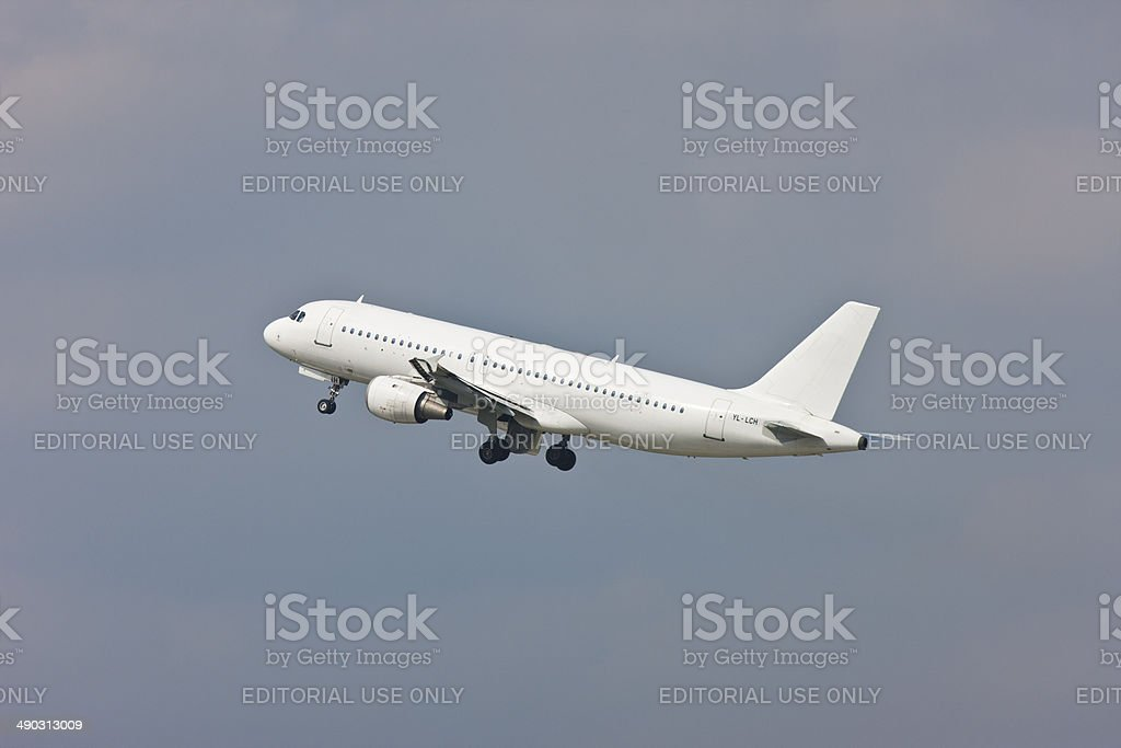 Airbus A319 take off from D?sseldorf International Airport stock photo