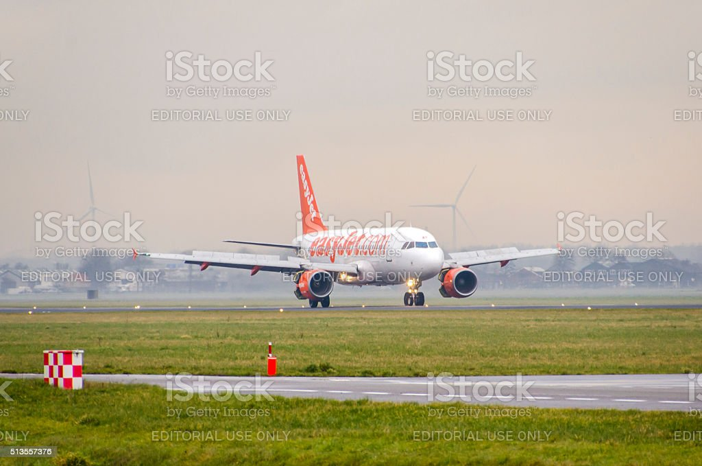 Airbus A319-111 of EasyJet landing at Schiphol stock photo