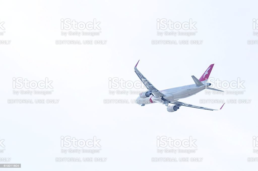 Airbus A320 by AirArabia in the sky stock photo