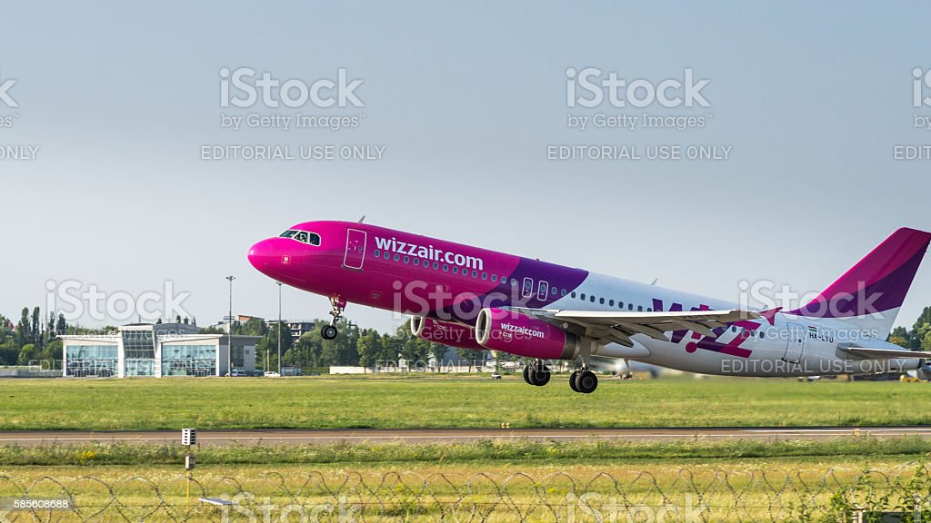 Airbus A320 by WizzAir take off stock photo