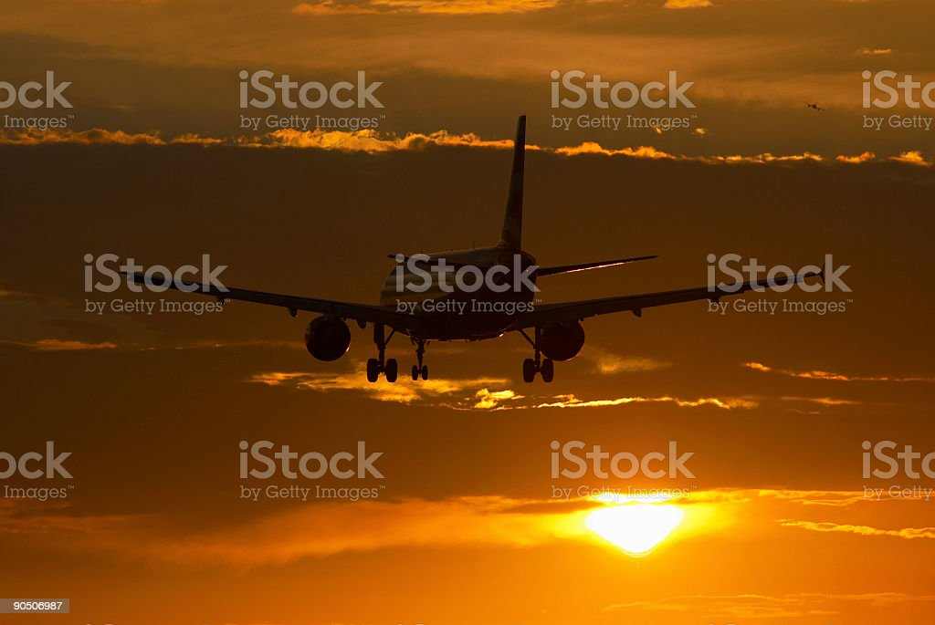 Airbus A320 Commercial Airliner Sunset Silhouette. stock photo