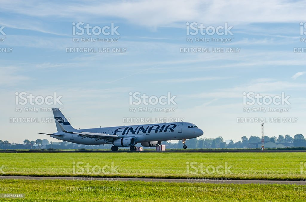Airbus A321 of Finnair landing at Schiphol stock photo