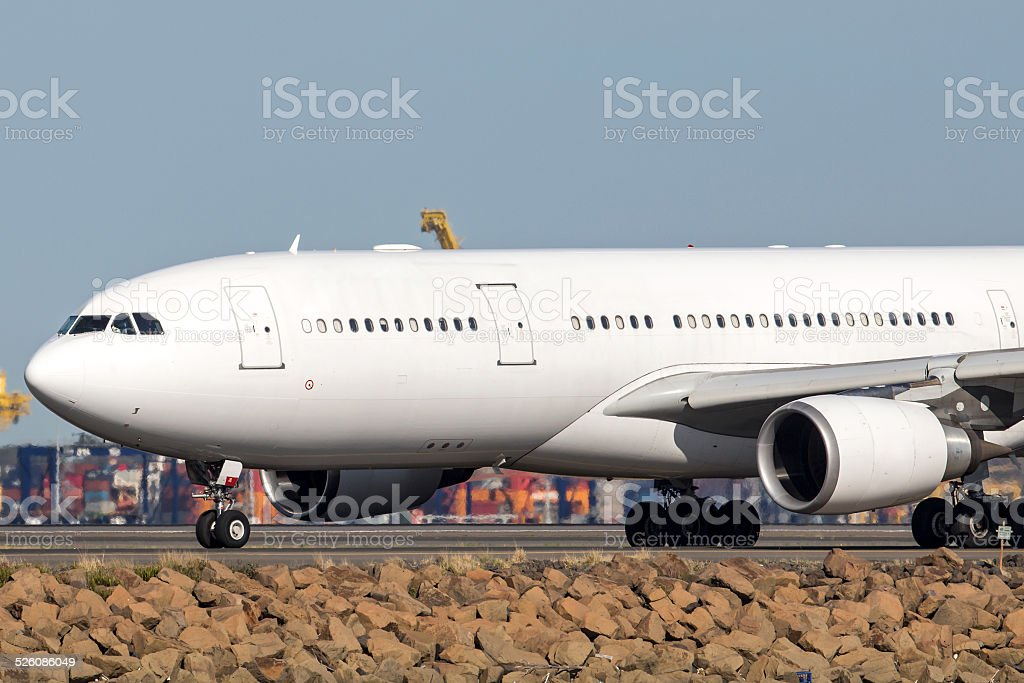 Airbus A330 Commercial airliner on a runway stock photo