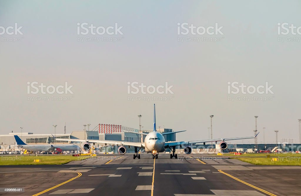 Airbus A340 taxiing to the runway stock photo