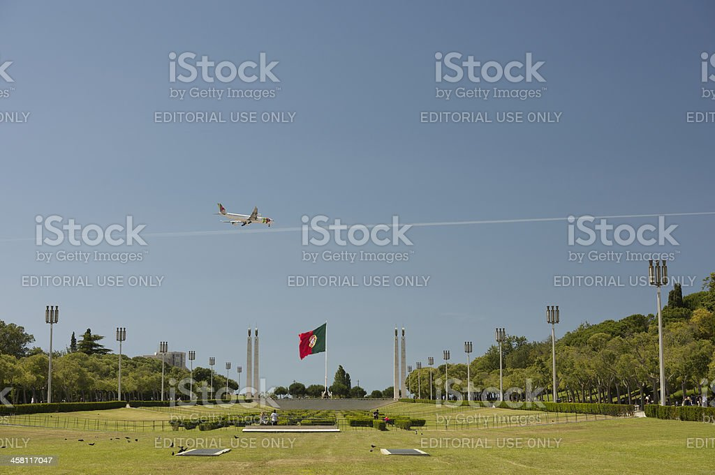 Airbus A340-300 passing over Edward VII Park in Lisbon, Portugal royalty-free stock photo