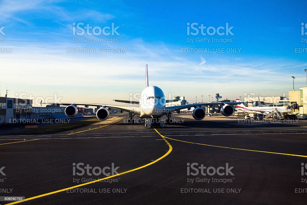Airbus A380 is transported by special  drawing vehicle on  runway stock photo
