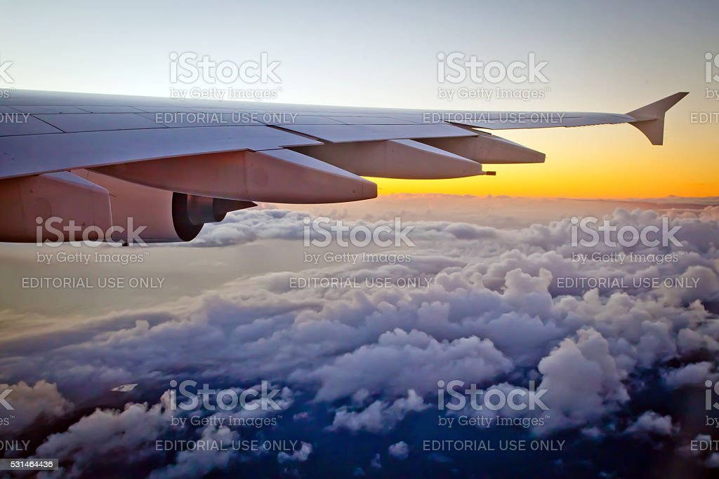 Airbus A380-800 - Looking out window to sunset during flight stock photo