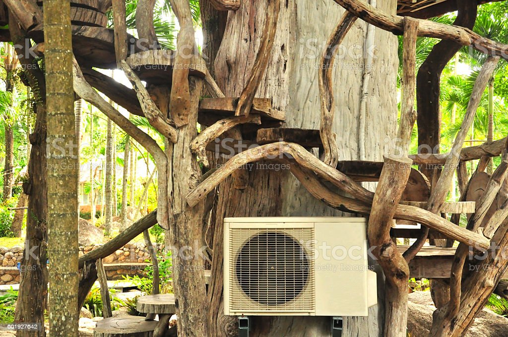 Aircondition and  big tree,Nature and Technology Concepted stock photo