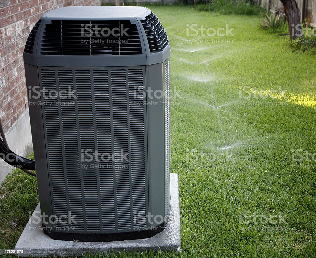Airconditioner and sprinklers stock photo