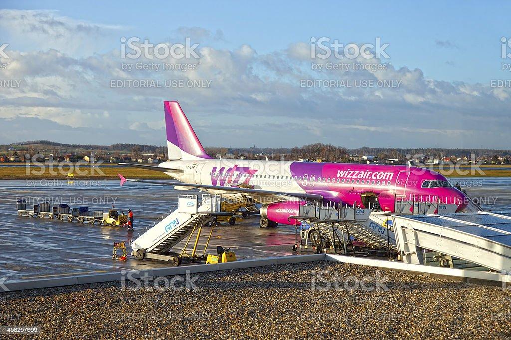 Aircraft at airport terminal royalty-free stock photo