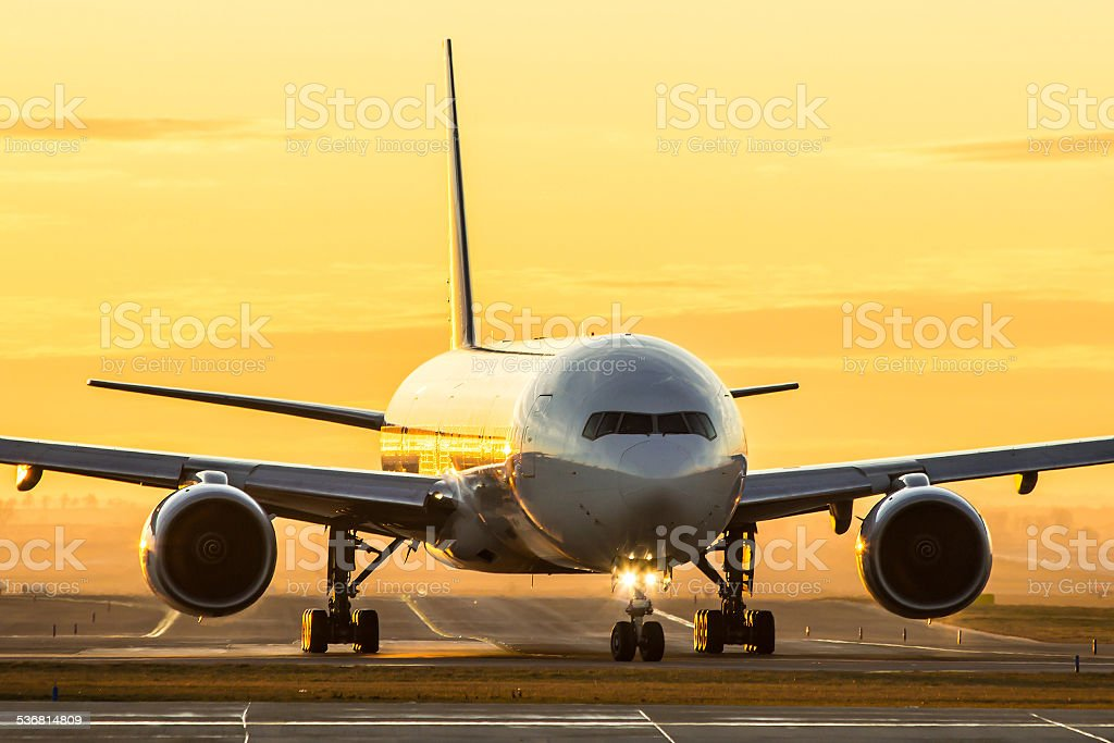 Aircraft at sunset stock photo