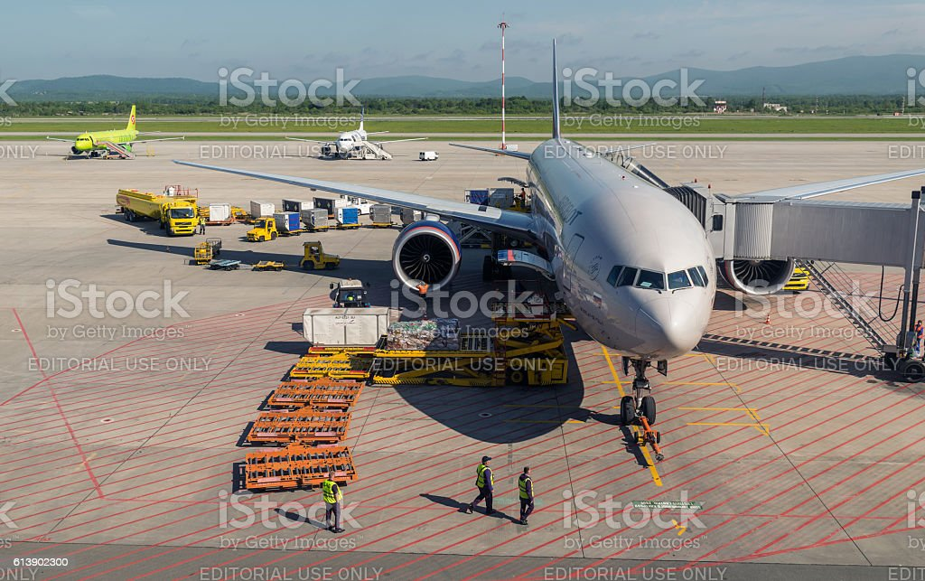 Aircraft being serviced on the airport. stock photo