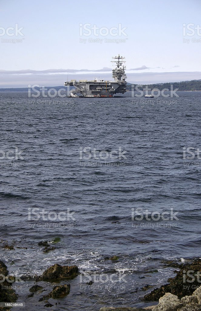 Aircraft Carrier anchored stock photo