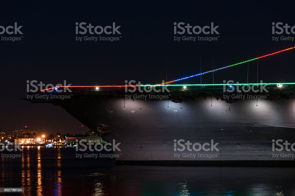 Aircraft carrier at night stock photo