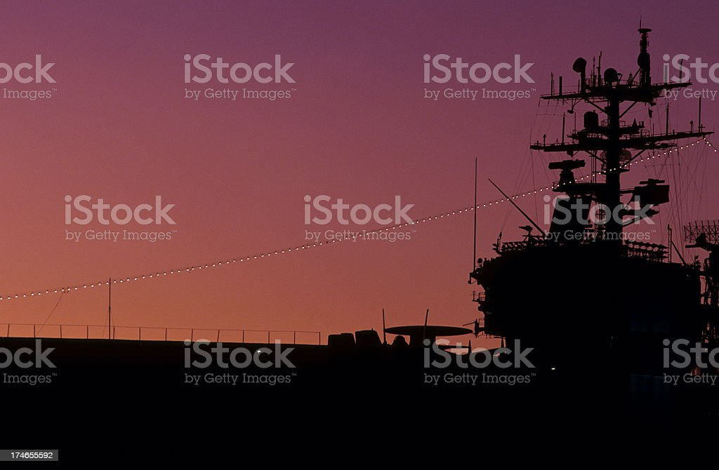 Aircraft carrier at sunset stock photo