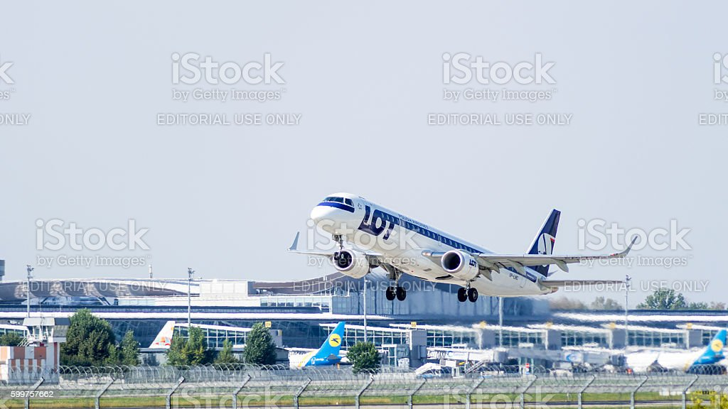 Aircraft Embraer by LOT - Polish Airlines take-off stock photo