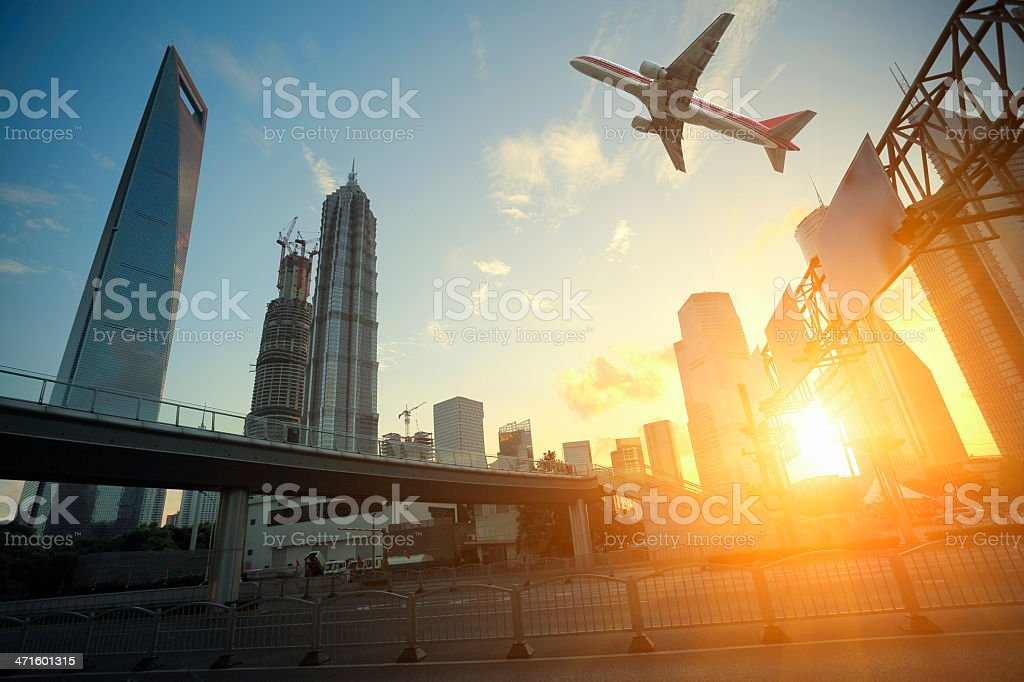 Aircraft flying over buildings in Shanghai stock photo